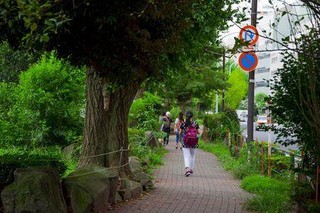 Tokyo, Japan, Ueno Animal Park, around the lake trail, pedestrians walking 版權商用圖片
