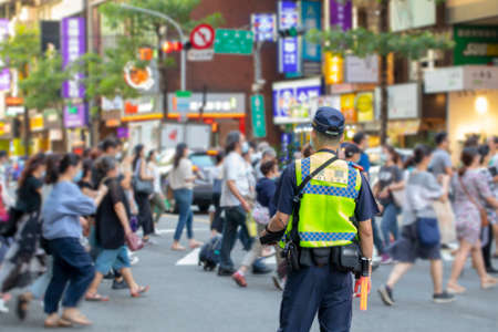The police patrolling at the crossroads to guard the safety of the people Stock Photo