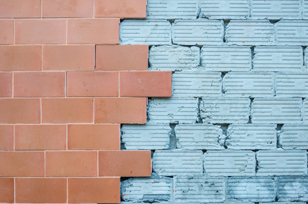Red brick and gray empty cement wall background Standard-Bild