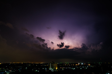 Clouds and thunder lightnings and storm in the city