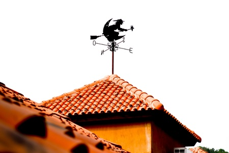 An isolated witch form wind vane  on orange roof Stock Photo - 14805666