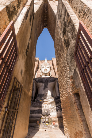 subduing: Large ancient Buddha image in Subduing Mara  Stock Photo