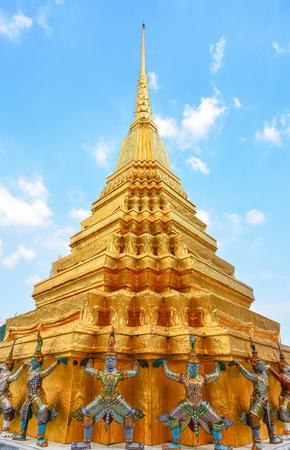 vibrance: Thai giant statues at golden pagoda base Stock Photo