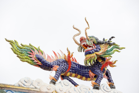 festival scales: Chinese dragon statue above the entrance to a Chinese temple.
