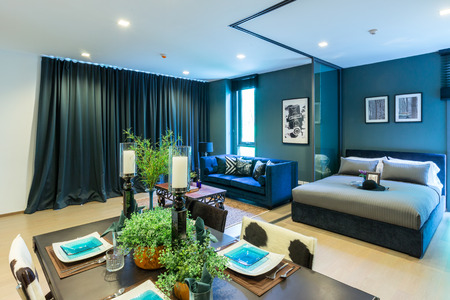 khaoyai: NAKHORNRATCHASIMA  THAILAND OCT 11: Luxury Interior living room with kitchen zone and restaurant set atthe valley khaoyai condominium on october 11,2015