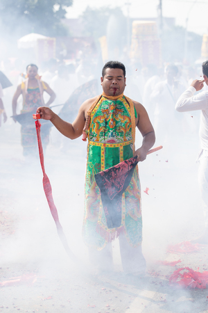 possess: Nakhon Ratchasima, THAILAND - OCT 16 : An unidentified devotee of Vegetarian Festival, person who invites the spirits of gods to possess their bodies on October 16, 2015 in Nakhon Ratchasima, Thailand Editorial