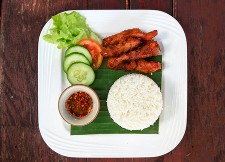 Fried Pork with Garlic Pepper on Rice