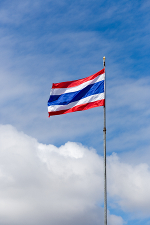 flagstaff: Image of waving Thai flag of Thailand with blue sky background.