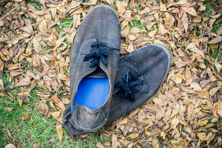 Vintage shoes placed on the grass Stock Photo