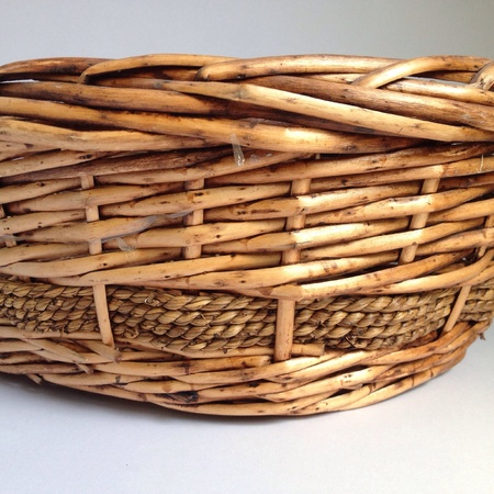 weave: Weave wicker basket isolated on light gray .