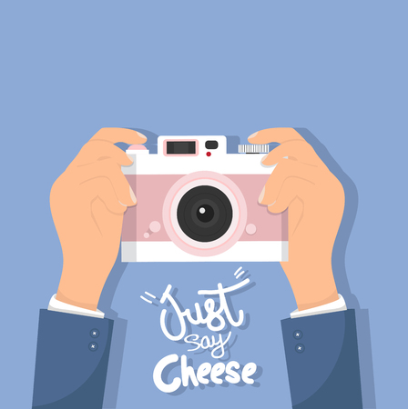 Hand Holding camera with just say cheese