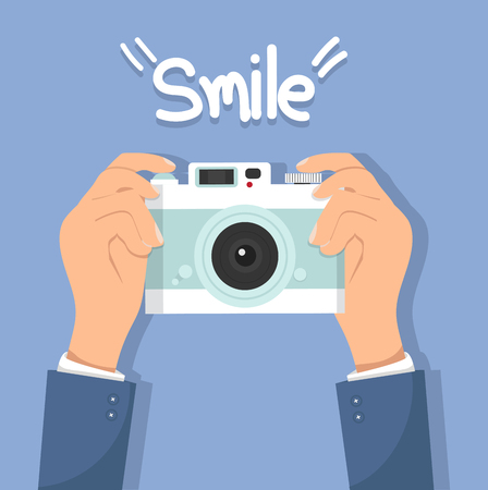 hand Holding camera with smile