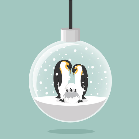 christmas ball with  Penguins family in egg
