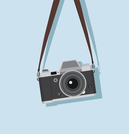 appareil photo vintage suspendu dans un style plat