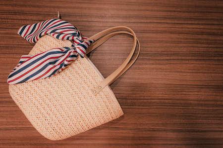 Stylish beach bag on wood background