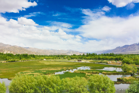 Beautiful landscape view from Shey Palace. background with blue sky, clouds and Himalaya mountains in Ladakh, India. Indian Tibet region in Jammu and Kashmir, India. Stock Photo
