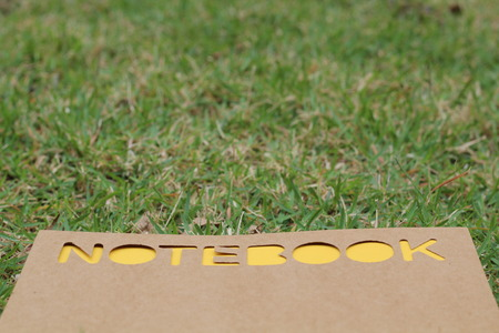 notebook on the green grass Stock Photo