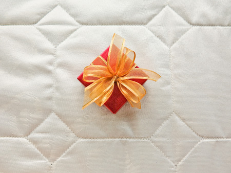 localities: red gift box with ribbon isolated on background