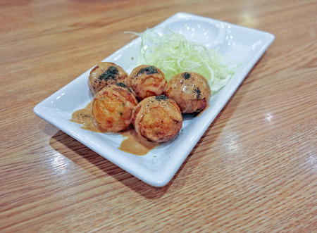 snack time: Takoyaki delicious Japanese style octopus pancake topping with multiple seasoning snack time Stock Photo