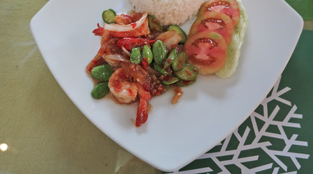 edibles: Thai food, shrimp ,with chili pepper and sweet basil