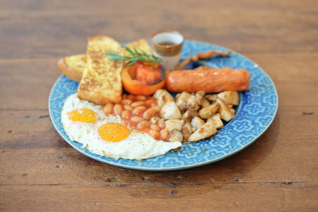 portly: breakfast with egg, mushroom,  nut ,sausage and bread for healthy Stock Photo