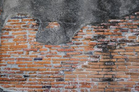 Grunge dirty old brick stone wall exterior on ancient temple architecture in Ayutthaya, Thailand. Weathered textured pattern background with copy space for text Stok Fotoğraf - 137887370