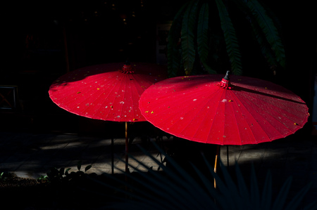fall protection: low key red umbrella Stock Photo