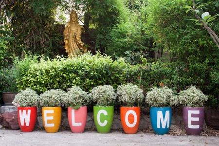 word WELCOME and goddess Kyun Yin satatue