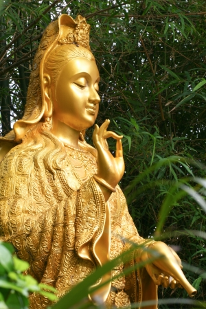 goodluck: Kuan yin goddessstatue in blessing  Meaning goodluck  Stock Photo