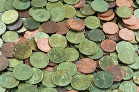 coins shot in golden color: Heap of Thai bath background. This coins is 50 Satang coins
