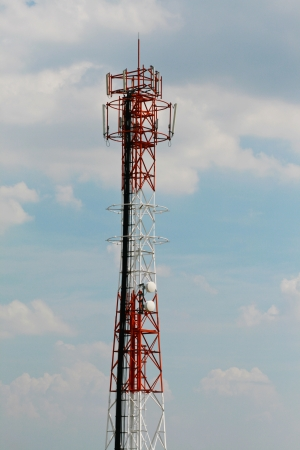 Alone cellphone telecommunication tower on cloudy day. photo