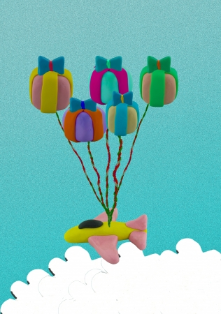 Flying jet airplane use gift box like balloon. This picture concept like fly higher. photo