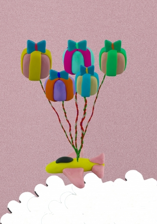 Flying jet airplane use gift box like balloon. This picture concept like fly higher. Stock Photo