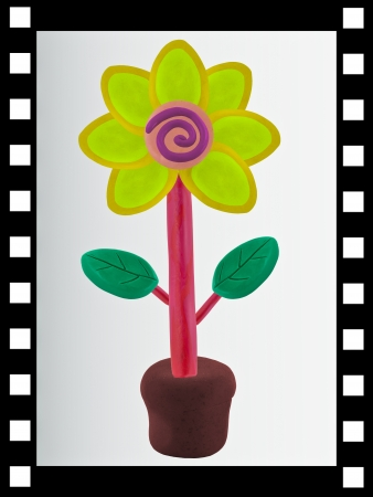 The single film strip and has flower made from clay sculpting technic inside  photo