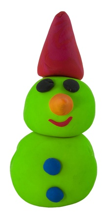 Happy green snowman with hat made from clay on white Stock Photo - 16459710