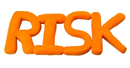 Orange risk wording made from clay Stock Photo - 17087229
