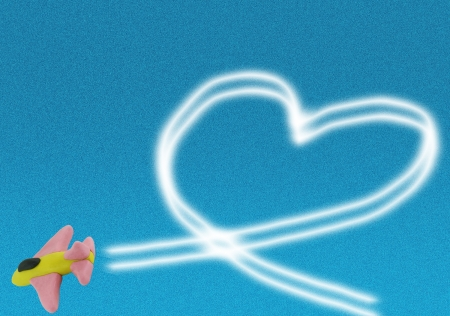 Cute clay jet fighter on bluesky draw heart by smoke photo
