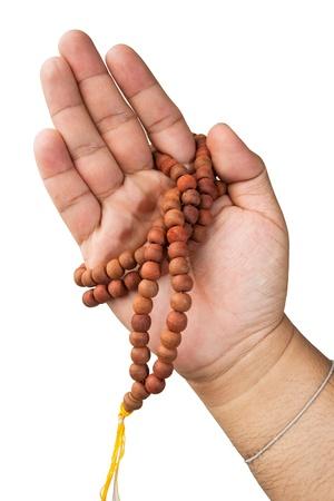 Hand with Buddhist rosary like praying