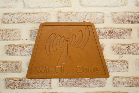 Brown wood wifi sign on brick photo