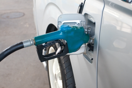 Blue Fuel nozzle add fuel in car in gas staion photo
