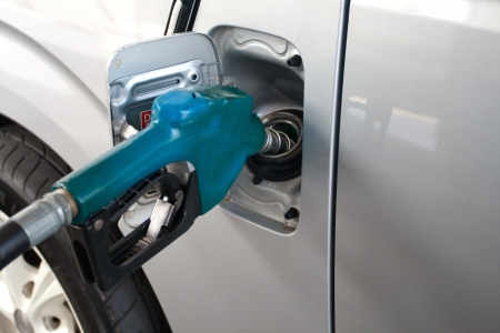 Blue Fuel nozzle add fuel in car in gas staion Stock Photo