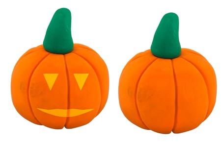 jack o  lanterns: Orange jack o lanterns and pumpkin made from clay
