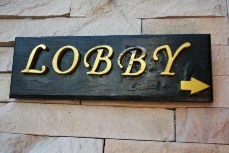 Lobby sign on brick background Stock Photo