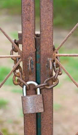 slammer: Old rust lock and chain in concept security Stock Photo