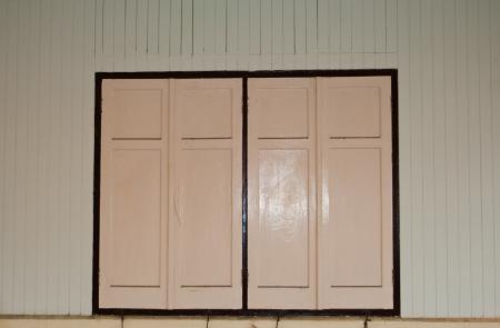 close old wood window on wood wall photo