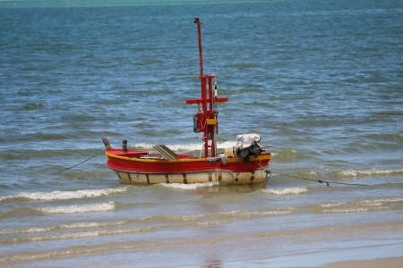 Alone  landing boat on beach in blue water Stock Photo