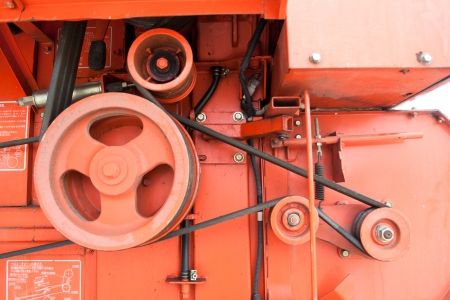 orange Cog and gear of engine and belt photo