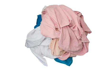 Unwashed clothes on white isolated background use for concept dirty or unclean Stock Photo
