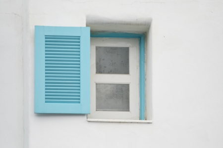 blue Windows on white wall photo