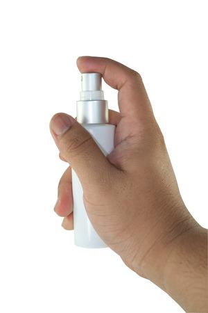 Hand holding spray bottle like use tonic Stock Photo